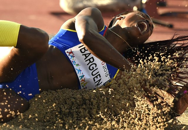 Caterine Ibarguen of Colombia lands during the Women's Triple Jump Finals at the CIBC Athletics Stadium at the Toronto 2015 Pan American Games in Toronto, Canada July  21, 2015. (Photo by Timothy A. Clary/AFP Photo)