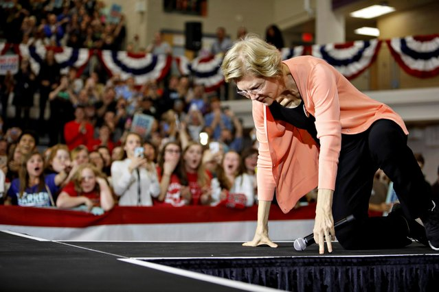 Democratic 2020 U.S. presidential candidate Sen. Elizabeth Warren goes down to her knees after tripping while ascending the stage at the start of a political rally in Raleigh, North Carolina, U.S. November 7, 2019. (Photo by Jonathan Drake/Reuters)
