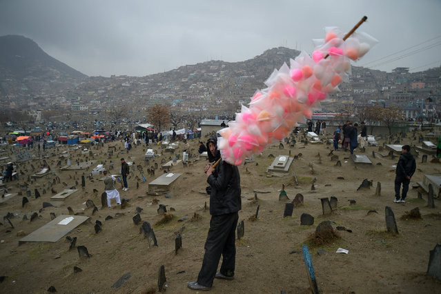 An Afghan vendor sells candy floss in Kabul on March 21, 2017, during Nowruz festivities as devotees mark the Afghan New Year. Nowruz, one of the biggest festivals of the war-scarred nation, marks the first day of spring and the beginning of the year in the Persian calendar. Nowruz is calculated according to a solar calendar, this coming year marking 1396. (Photo by Shah Marai/AFP Photo)