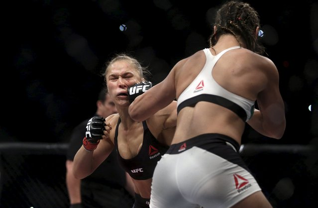 Ronda Rousey (L) of U.S fights with Bethe Correia of Brazil during their Ultimate Fighting Championship (UFC) match, a professional mixed martial arts (MMA) competition in Rio de Janeiro, Brazil August 1, 2015. (Photo by Ricardo Moraes/Reuters)
