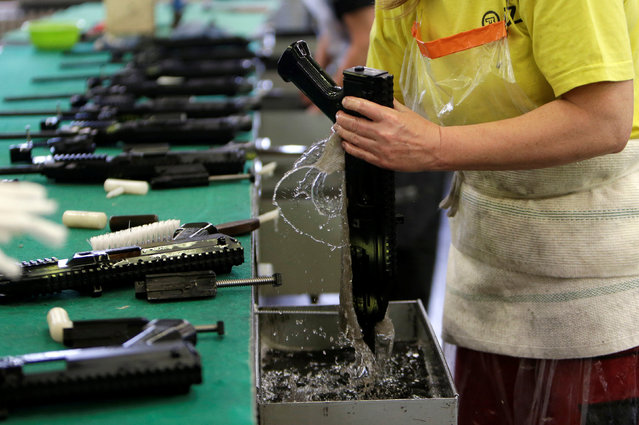 A worker cleans a gun in the Ceska Zbrojovka weapons factory in Uhersky Brod, Czech Republic, May 27, 2016. (Photo by David W. Cerny/Reuters)