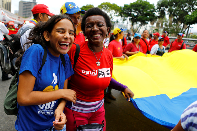 Pro-government supporters attend a rally of members of the education sector in Caracas, Venezuela June 14, 2016. (Photo by Ivan Alvarado/Reuters)