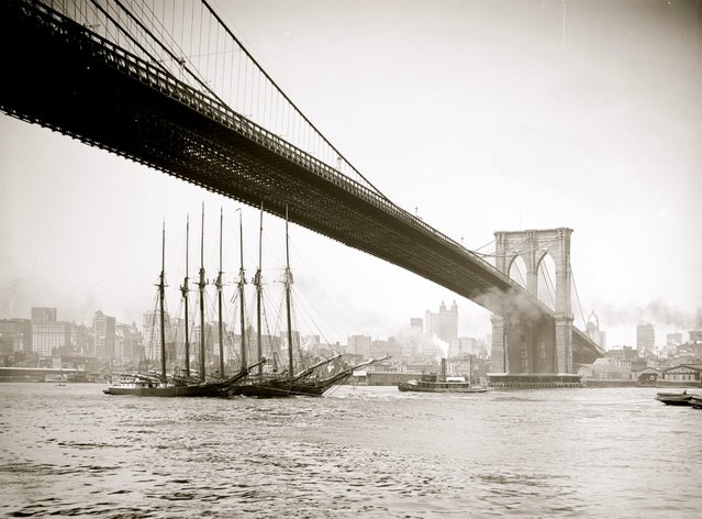 A view of New York City from under the Brooklyn Bridge with a masted schooner visible in the East River, 1903. (Photo by Buyenlarge/Getty Images)