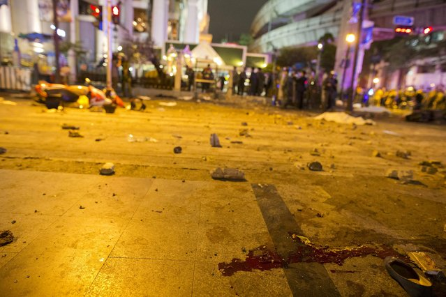 Blood is seen near a victim's shoe, as security forces and emergency workers gather at the scene of a blast in central Bangkok August 17, 2015. (Photo by Athit Perawongmetha/Reuters)