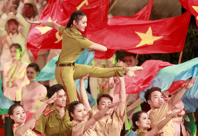People perform during celebrations to commemorate the 70th anniversary of the establishment of the Vietnam Public Security police force at the National Convention Center in Hanoi August 18, 2015. The Vietnam Police force was founded on August 19, 1945, the day of the anti-colonial people's uprising known as the August Revolution. (Photo by Reuters/Kham)