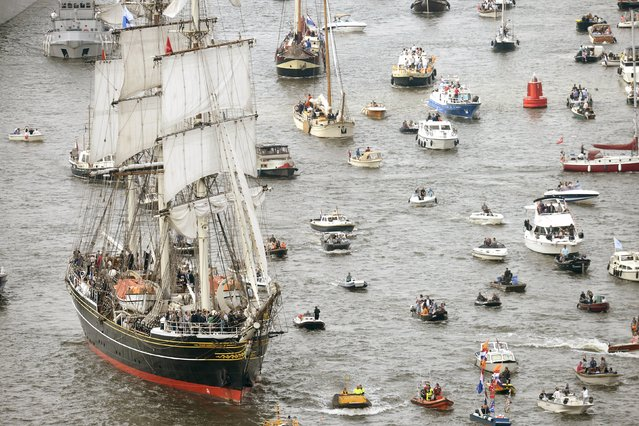 The Stad Amsterdam (L) clipper sails during the Sail-In Parade marking the beginning of the Sail Amsterdam 2015 nautical festival held every five years in Amsterdam, Netherlands August 19, 2015. (Photo by Toussaint Kluiters/Reuters/United Photos)