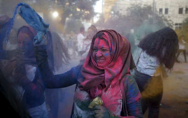 A Palestinian reveller takes part in a colours festival organized by Palestinian activists in the West Bank city of Ramallah August 20, 2015. (Photo by Mohamad Torokman/Reuters)