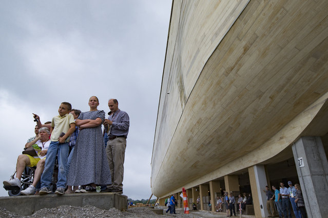 Visitors roam the Ark Encounter theme park as a replica of Noah's Ark stands in the background during a media preview day, Tuesday, July 5, 2016, in Williamstown, Ky. (Photo by John Minchillo/AP Photo)