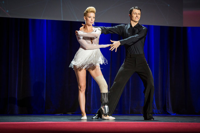 In this photo provided by TED 2014 Conference, dancer Adrianne Haslet-Davis, left, performs on stage with dancer Christian Lightner at the 2014 TED Conference, in Vancouver, British Columbia, on March 19, 2014. Haslet-Davis took to the stage with a new prosthetic limb to perform for the first time since losing part of her left leg in the 2013 Boston Marathon bombing. (Photo by James Duncan Davidson/AP Photo/TED 2014 Conference)