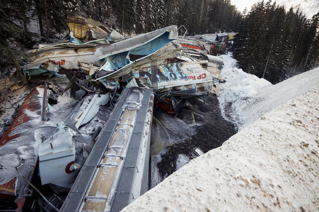 A train derailment is shown near Field, B.C., Canada on February 4, 2019. A union representative says a Canadian Pacific freight train fell more than 60 metres from a bridge near the Alberta-British Columbia boundary in a derailment that killed three crew members. The westbound freight jumped the tracks Monday at about 1 a.m. near Field, B.C. (Photo by Canadian Press/Rex Features/Shutterstock)