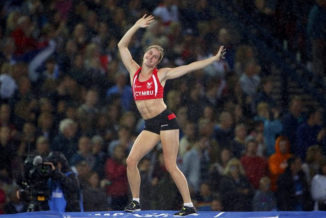 Sally Peake of Wales reacts after clearing the bar in the women's pole vault final at the 2014 Commonwealth Games in Glasgow, Scotland, August 2, 2014. (Photo by Phil Noble/Reuters)