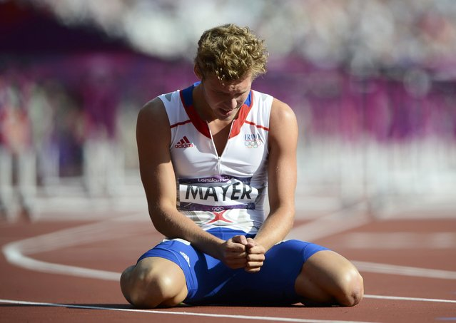 France's Kevin Mayer reacts after his men's decathlon 110m hurdles heat during the London 2012 Olympic Games at the Olympic Stadium August 9, 2012. (Photo by Dylan Martinez/Reuters)