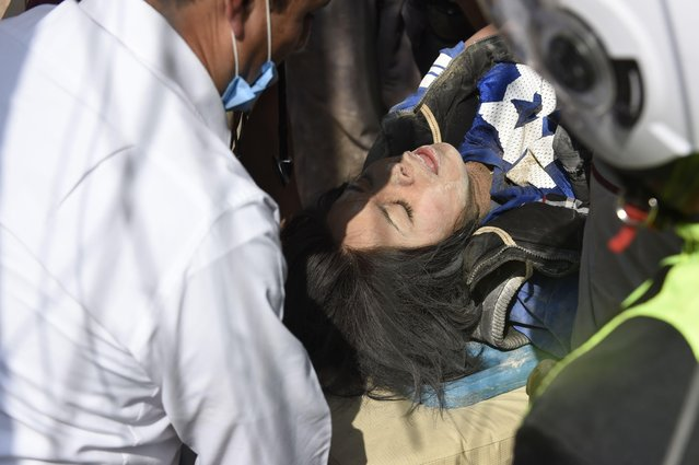 A person rescued from the rubble gets medical assistance after a powerful quake in Mexico City on September 19, 2017. A powerful earthquake shook Mexico City on Tuesday, causing panic among the megalopolis' 20 million inhabitants on the 32 nd anniversary of a devastating 1985 quake. The US Geological Survey put the quake' s magnitude at 7.1 while Mexico' s Seismological Institute said it measured 6.8 on its scale. The institute said the quake' s epicenter was seven kilometers west of Chiautla de Tapia, in the neighboring state of Puebla. (Photo by Alfredo Estrella/AFP Photo)