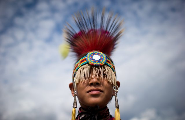 A boy from the Musqueam First Nation in Vancouver waits to participate in the Squamish Nation Youth Pow Wow in North Vancouver,  British Columbia, on Sunday, August 31, 2014. Approximate 140 dancers gathered to compete in the 27th annual event that draws dancers from as far as Manitoba and the United States to compete for cash prizes. (Photo by Darryl Dyck/AP Photo/The Canadian Press)