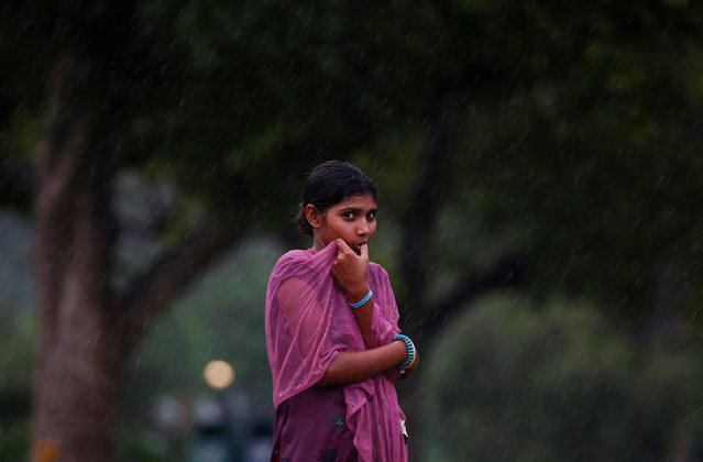 A girl is seen as it rains in New Delhi, India August 1, 2016. (Photo by Adnan Abidi/Reuters)