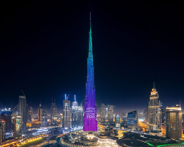 """A handout image made available by the Mohammed Bin Rashid Al Maktoum Global Initiatives (MBRGI) on May 12, 2020, shows Burj Khalifa during a light show to mark """"10 million meals"""" Covid-19 campaign. One pixel at a time, Dubai will light up the facade of the world's tallest building to represent each donation made to relieve coronavirus-hit communities across the United Arab Emirates. The Burj Khalifa, which stands 828 metres (2,717 feet) high, was transformed into the """"world's tallest donation box"""" as part of a campaign to provide 10 million meals to low-income people. (Photo by Mohammed Bin Rashid Al Maktoum Global Initiatives/AFP Photo)"""