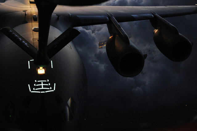 Utah Air National Guard Airmen conduct air refueling operations with a C-17 Globemaster III assigned to Joint Base Lewis-McCord, Wash., over southern Idaho. The Airmen are assigned to the 151st Air Refueling Wing at Salt Lake City Air National Guard Base, Utah, and support air operations across the western United States. (Photo by USAF)