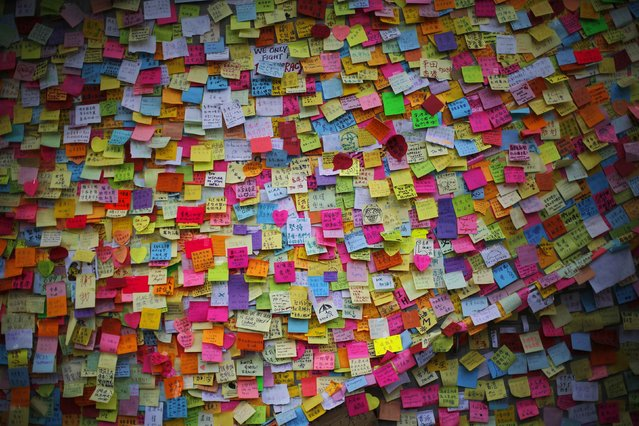 Messages of support for pro-democracy demonstrations are seen on a wall near the government headquarters in Hong Kong October 8, 2014. (Photo by Carlos Barria/Reuters)
