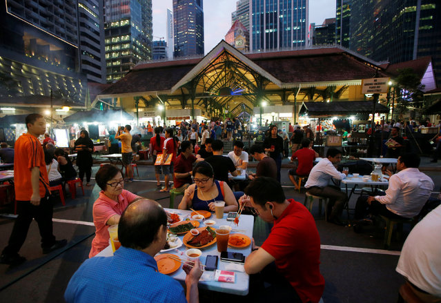 People eat at Lau Pa Sat food centre in Singapore July 29, 2016. (Photo by Edgar Su/Reuters)