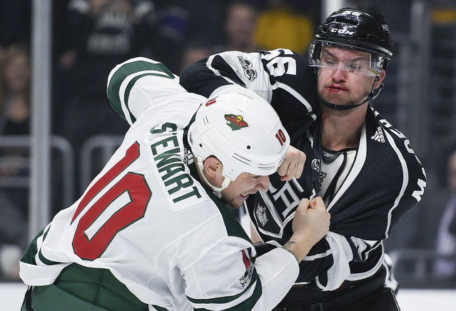 Los Angeles Kings defenseman Kurtis MacDermid, right, fights Minnesota Wild right wing Chris Stewart during the first period of an NHL hockey game in Los Angeles, Tuesday, December 5, 2017. (Photo by Kelvin Kuo/AP Photo)