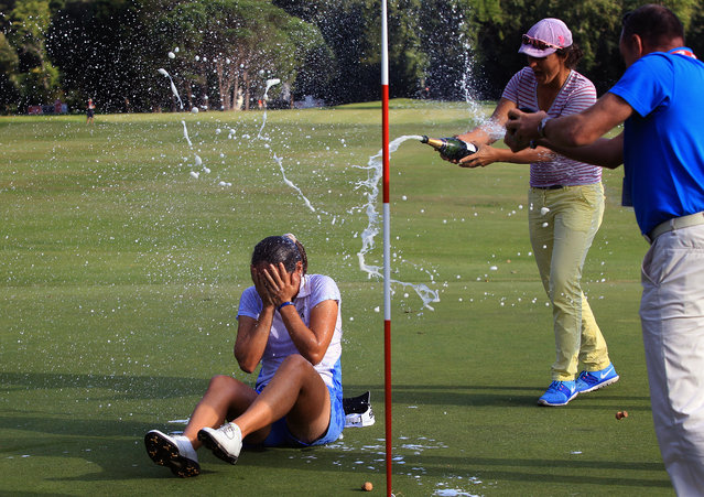 Celine Herbin of France gets sprayed with champagne after winning the women's Lacoste Open in Saint Jean de Luz, southwestern France, Sunday, September 27, 2015. (Photo by Bob Edme/AP Photo)