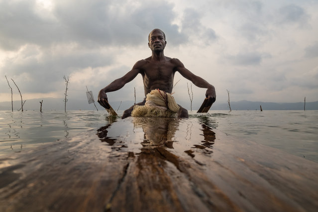 This 1 million-year-old lake was created when a giant meteorite crash-landed in what was once a lush rainforest. In the Ghana's Ashanti region, lake Bosumtwi is revered as sacred and tradition dictates that locals can only fish there using wooden planks called paduas. (Photo by Joel Santos/Barcroft Images)