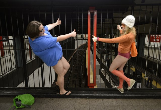 Some riders in the New York City subway in the underwear as the take part in the 2013 No Pants Subway Ride January 13, 2013. Started by Improv Everywhere, the goal is for riders to get on the subway train dressed in normal winter clothes (without pants) and keep a straight face.  AFP PHOTO / TIMOTHY A. CLARY        (Photo credit should read TIMOTHY A. CLARY/AFP/Getty Images)