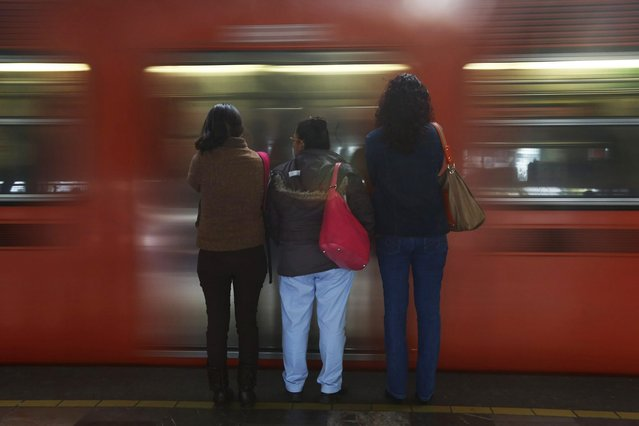 Passengers wait to board the Women-Only passenger car at a subway station in Mexico City October 23, 2014. (Photo by Edgard Garrido/Reuters)