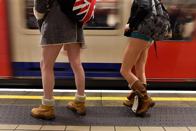 """A tube train arrives as people take part in the annual """"No Trousers On The Tube Day"""" (No Pants Subway Ride) on the Central line in London on January 7, 2018. (Photo by Ben Stansall/AFP Photo)"""