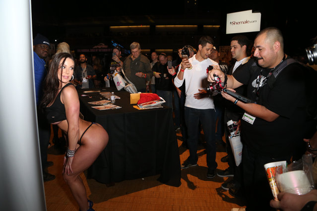Fans take photos of adult film actress Kendra Lust during the 2015 AVN Adult Entertainment Expo at the Hard Rock Hotel & Casino on January 22, 2015 in Las Vegas, Nevada. (Photo by Gabe Ginsberg/FilmMagic)