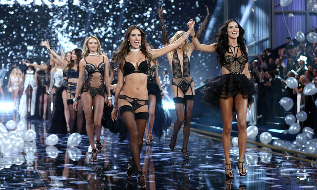 Alessandra Ambrosio (l) walks the runway at the annual Victoria's Secret fashion show at Earls Court on December 2, 2014 in London, England. (Photo by Tim P. Whitby/Getty Images)