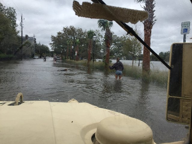 South Carolina National Guard Soldiers, with the 218th Maneuver Enhancement Brigade, arrive to help a citizen stranded at Colonial Lake in Charleston, South Carolina, U.S., October 8, 2016. (Photo by Reuters/Courtesy of the South Carolina National Guard)