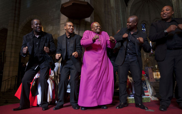 Archbishop Emeritus Desmond Tutu (C) dances with the Cape Town Opera Ensemble at the Templeton Prize celebration at St. George's Cathedral in Cape Town in this April 11, 2013 photo by Templeton Prize. South African anti-apartheid campaigner Tutu has won the 2013 Templeton Prize worth $1.7 million for helping inspire people around the world by promoting forgiveness and justice, organisers said on Thursday. A leading human rights activist of the late 20th century, the former Anglican archbishop of Cape Town played a pivotal role in the downfall of apartheid and subsequently worked to heal wounds in South Africa's traumatised society. (Photo by Ilan Godfrey/Reuters/Templeton Prize)