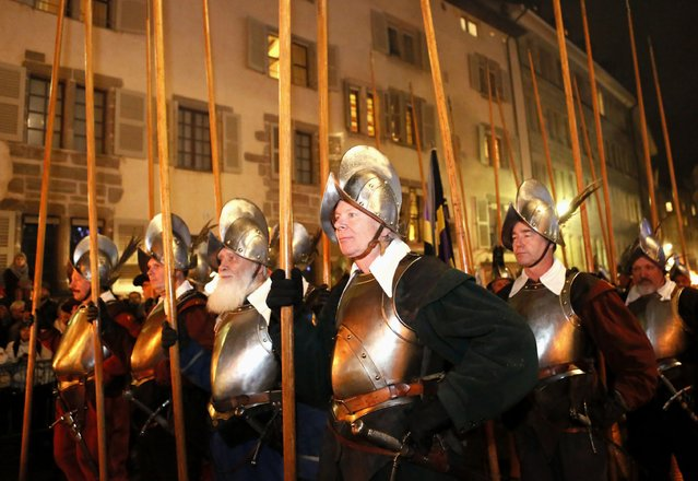 Pikemen of the Compagnie 1602 take part in a procession in Geneva December 14, 2014. (Photo by Pierre Albouy/Reuters)