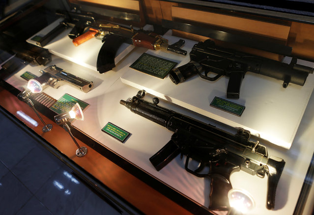 Guns are displayed in the Drugs Museum, used by the military to showcase to soldiers the lifestyles of Mexican drug lords, at the headquarters of the Ministry of Defense in Mexico City, October 14, 2016. (Photo by Henry Romero/Reuters)
