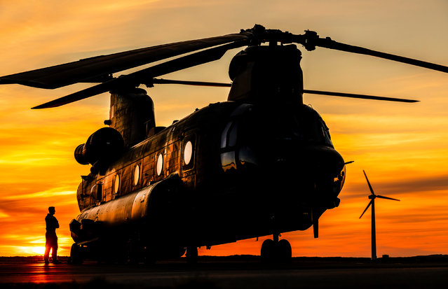 Other entries. An RAF CH-47 Chinook of 18 Squadron, from RAF Odiham, pauses between training sorties at Caernarfon airport after a refuel. This image was one of 900 submitted to this year's competition. (Photo by Cpl Tim Laurence/2020 RAF Photo Competition)