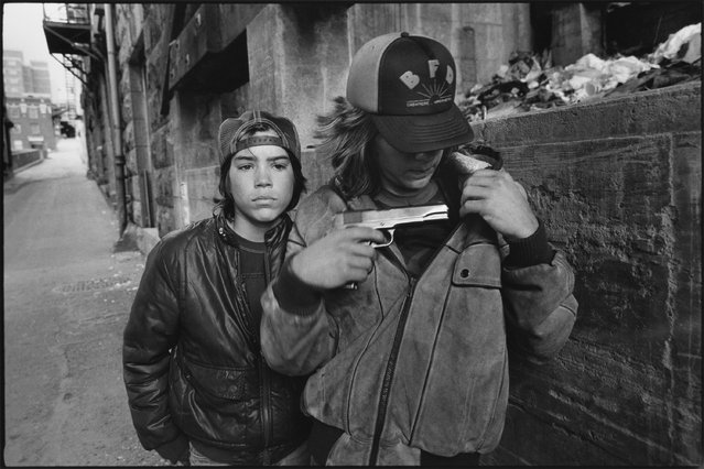 """Rat"" and Mike with a gun, Seattle, Washington, 1983. (Photo by Mary Ellen Mark)"