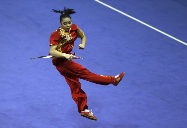 Indonesia's Juwita Niza Wasni competes in the women's nandao final during the 13th World Wushu Championship 2015 at Istora Senayan stadium in Jakarta, November 17, 2015. (Photo by Reuters/Beawiharta)
