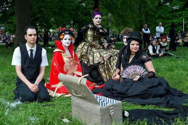 Participants in costumes attend the traditional park picnic on the first day of the annual Wave-Gotik Treffen, or Wave and Goth Festival, on May 17, 2013 in Leipzig, Germany. The four-day festival, in which elaborate fashion is a must, brings together over 20,000 Wave, Goth and steam punk enthusiasts from all over the world for concerts, readings, films, a Middle Ages market and workshops. (Photo by Marco Prosch)