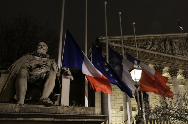 French and European flags fly at half-mast outside the National Assembly in Paris January 7, 2015, following a shooting by gunmen at the offices of weekly satirical magazine Charlie Hebdo. (Photo by Jacky Naegelen/Reuters)