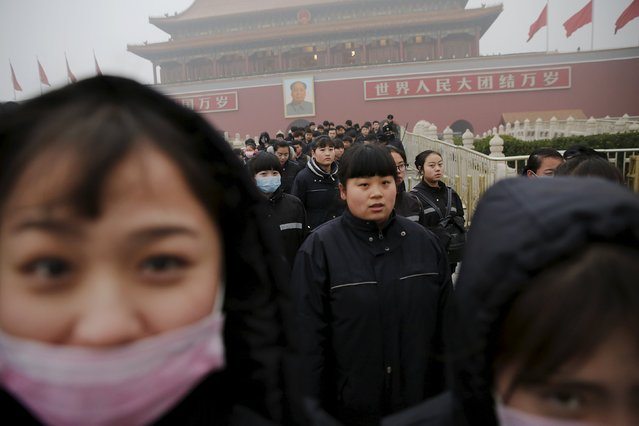 Women walk out of the Tiananmen Gate on an extremely polluted day as hazardous, choking smog continues to blanket Beijing, China December 1, 2015. (Photo by Damir Sagolj/Reuters)