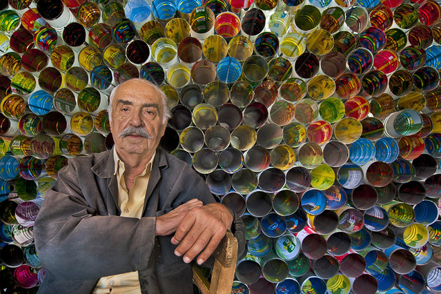"""""""Tinman"""". Fikret the tinman lives in Tarsus. he is the expert of recycling. He makes stovepipe using tins of tomato, cheese and pickle. After I met him, I put colorful tins in a line. I took his photo of happiness, the image was like a honey comb and a colorful rainbow. Location: Turkey, Tarsus. (Photo and caption by Melih Sular/National Geographic Traveler Photo Contest)"""