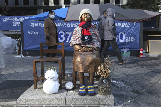 A statue symbolizing a wartime s*x slave is displayed near the Japanese Embassy in Seoul, South Korea, Friday, January 8, 2021. A South Korean court on Friday ordered Japan to financially compensate 12 South Korean women forced to work as s*x slaves for Japanese troops during World War II, the first such ruling expected to rekindle animosities between the Asian neighbors. (Photo by Ahn Young-joon/AP Photo)