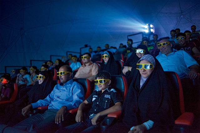 Shaking seats and wind machines thrill moviegoers during a 3-D film at a theater closed during the war in Baghdad, 2010. (Photo by Lynsey Addario/National Geographic)