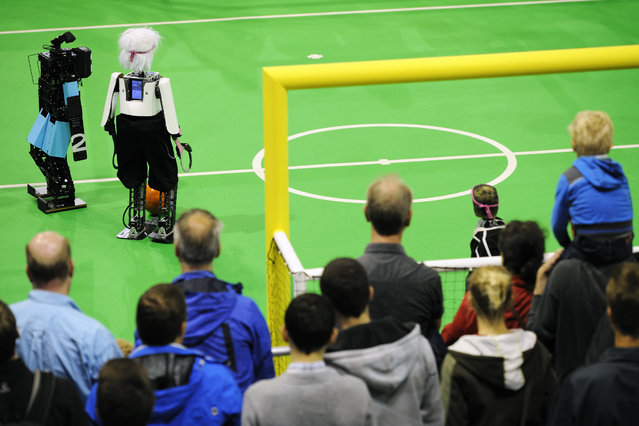 lota of spectators during finals Soccer Humanoid Teen size (NimbRo / Germany (hairy robot) vs CIT Brains) at the World Championship finals of RoboCup 2013 in Eindhoven (NL). (Photo by Bart van Overbeeke)