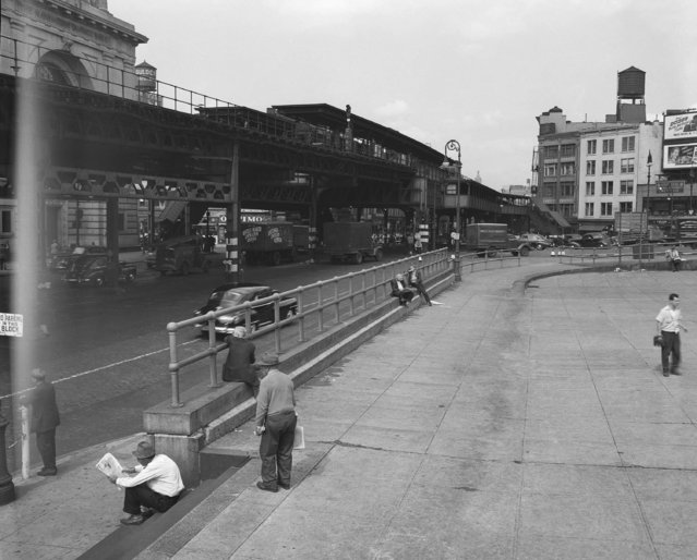 The photo shows the Bowery where it intersects with Canal Street in New York, 1947. The Third Avenue El, or, Elevated, train is on the left. (Photo by Ed Ford/AP Photo)