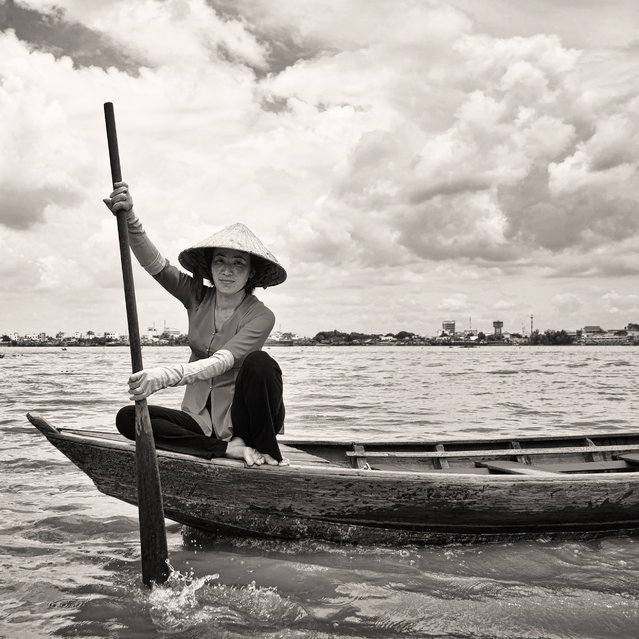 """Mekong Lady"". Very nice posing of Mekong lady come across my boat... Love her smile very much. Location: Mekong River, Ho Chi Minh. (Photo and caption by Suhaimi Mat Isa/National Geographic Traveler Photo Contest)"