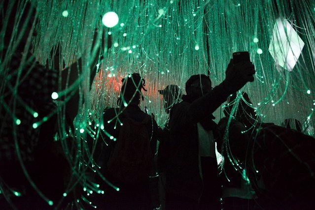 """People interact with the """"joyful"""" room at the Museum of Feelings, a pop-up installation in New York in New York, December 15, 2015. (Photo by Stephanie Keith/Reuters)"""