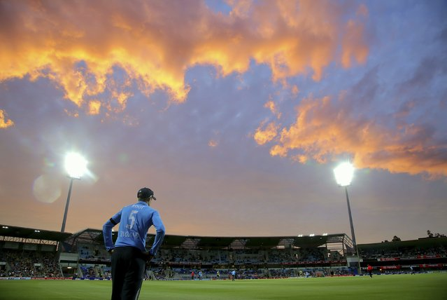England's Joe Root fields on the boundary as the sun sets during their One Day International (ODI) tri-series cricket match against Australia at Bellerive Oval in Hobart, Tasmania January 23, 2015. (Photo by Hamish Blair/Reuters)