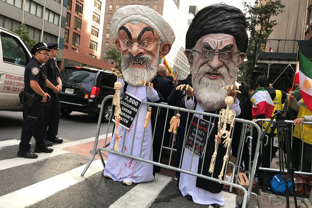 People dressed as Iran's Supreme Leader, Ayatollah Ali Khamenei and Iranian President Hassan Rouhani protest on the street against Iran in New York, New York, U.S., September 24, 2018. (Photo by Carlo Allegri/Reuters)
